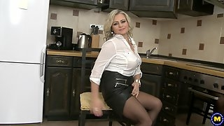 Lexa takes off her leather skirt and masturbates in the kitchen