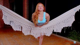 Redhead model Angelina Praga moans while fingering her taco